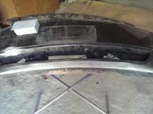 Шлифовка повреждений, нанесение шпаклевки по пластмассе